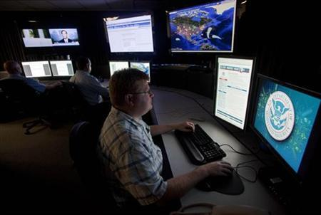 Analysts work in a watch and warning center of a cyber security defense lab at the Idaho National Laboratory